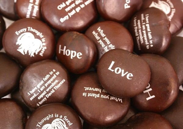 See Beans with words Love, Hope, and little quotes engraved on them