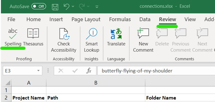 Review tab in Excel with Spelling menu item on the top left.