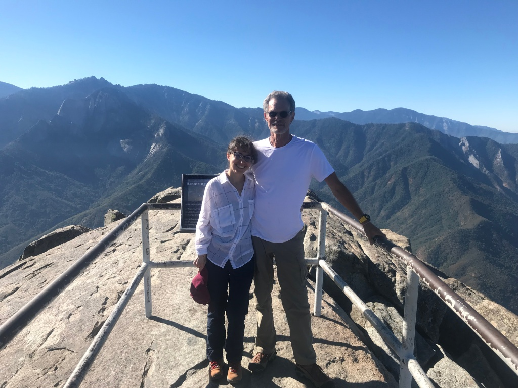 two people in love on top of Moro rock in Sequoia... climbing mountains together